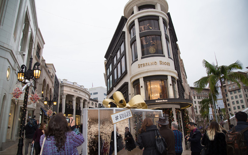 Take a selfie at the snowglobe on Rodeo Drive