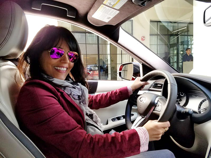 Mar Yvette in the driver's seat of the 2019 Infiniti QX50
